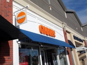 custom storefront blade projecting sign